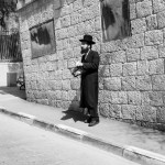 Different groups within the Haredi community wear distinctive styles of hats, coats, and other garments, following traditions traced back to the 18th century in specific Jewish communities across Europe.