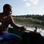 A boat man rows passengers on the Toa River, Baracoa.