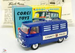 "Corgi 464 Commer ""County Police"" Van - blue body, red interior, silver trim, spun hubs, clear battery-operated roof light - Very near mint, most would say mint in a near mint and yellow carded picture box with correct collectors club/instruction sheet. A lovely bright example that displays very nicely."