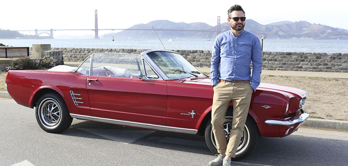 Fredrik Pferdt posing with his Mustang in San Francisco.