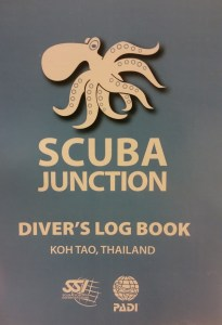 photo of my Scuba Junction Diver's log book. Blue and orange.