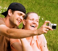 Couple using a digital camera