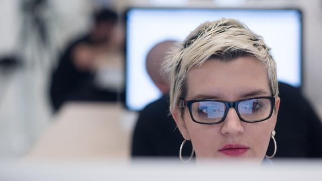woman using a computer UK Tech Sector