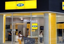 A shopper walks past an MTN shop at mall in Johannesburg