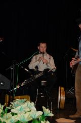 Darragh playing the high chiefton D whistle on stage.