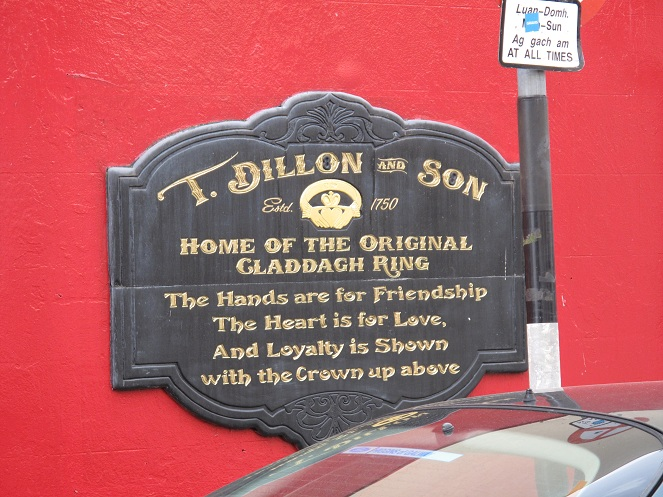 This is a plaque on the side of a building. It gives some of the history of Claddagh as it origionated in Galway.