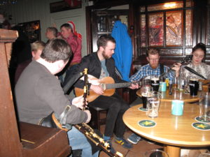 Musicians playing in toals. You can also see Darragh from the side.