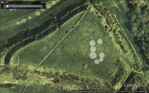 Abbotsbury Castle hillfort with 'hut circles' outlined in white.