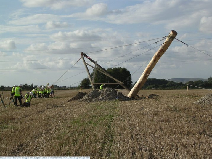 Image 6 - Time Team reconstruction, Durrington Walls, raising the first post. Image copyright Clive Ruggles.