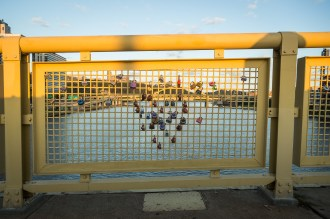 Locks celebrating couples on the Roberto Clemente bridge, looking across to the Frt. Duquense Bridge. August 2015.
