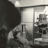 Wake Forest student with microscope