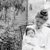 Woman with a child and doll in Salem