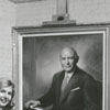 Unidentified woman with portrait of Charles Babcock, 1962.