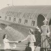 Fashion photo with Piedmont airplane, pilots, and models, 1948.