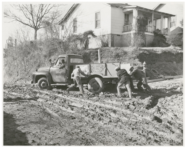 Crystal Ice and Coal Company truck mired in the mud at Twelfth Street and Pittsburg Avenue, 1958.