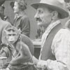 Harry Parker, Polidar, and Charlie (monkey) at the Flower Fair in Old Salem, 1958.