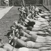 Linda Edwards, and other swimmers and sun bathers, at Reynolds Park pool, 1958.