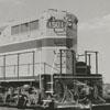 Southbound railroad diesel locomotive at North Winston yard, 1957.