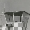 Mrs. Kem Naftel and William O'Neal , pilots, look at the mobile tower at Smith Reynolds Airport, 1957.