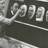 Betty Moore with wax casts of patient faces, 1956.