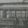 L. D. (Buck) Wood and Bob Marlow standing in front of the streetcar.