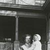 Nurse Lizzie Thompson holding Smith Reynolds.