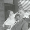 R. J. Reynolds holding his son, Smith.