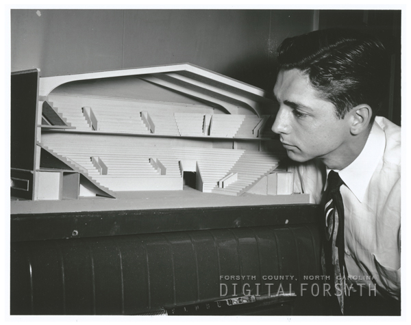 Architect working on a design model for the coliseum, 1950.