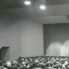 Interior view of the Little Theatre, showing the stage and seating, 1964.