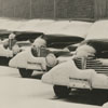 Snow on cars, possibly on a car lot, 1942.