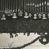 Choir members in the choir loft of an unidentified church.