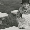 Unidentified woman cleaning a gravestone in one of the Moravian graveyards.