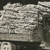 Truck loaded with tobacco parked outside of a tobacco warehouse, 1938.