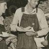Men, probably tobacco farmers, at the tobacco market, 1938.