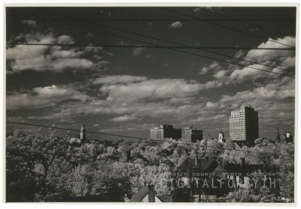 Downtown skyline, showing First Baptist Church, Robert E. Lee Hotel, Carolina Hotel & Theatre, and the Nissen Building, 1940.