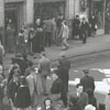 View of shoppers crossing North Liberty Street at West Fourth Street, 1938.