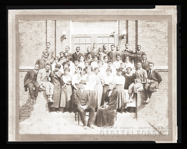Slater Industrial Academy 1915 student body and Dr. and Mrs. Simon Green Atkins.
