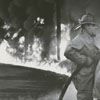 Firemen at a gasoline tank truck fire on East Fifth Street, 1969.