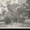 View of house and garden in the 600 block of West Fifth Street, 1924.