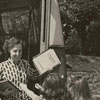 Mae Kreeger brings library books to home-bound children during polio outbreak, 1948.