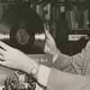 Forsyth County Public Library Director Paul S. Ballance with phonograph records, 1953.