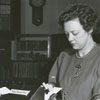 Jeannette Trotter, Carnegie Librarian, uses the new Gaylord charging machine for checking out books, 1947.
