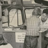 Library bookmobile interior with children and driver, Ted Carmichael.