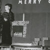 Carnegie Librarian, Margaret Moran, and boy decorating Christmas tree in the Carnegie Library.