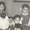 Children with dolls at East Winston Branch Library, 1964.
