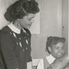 Mrs. Elizabeth Wright and Barbara Kelly at East Winston Branch Library, 1959.