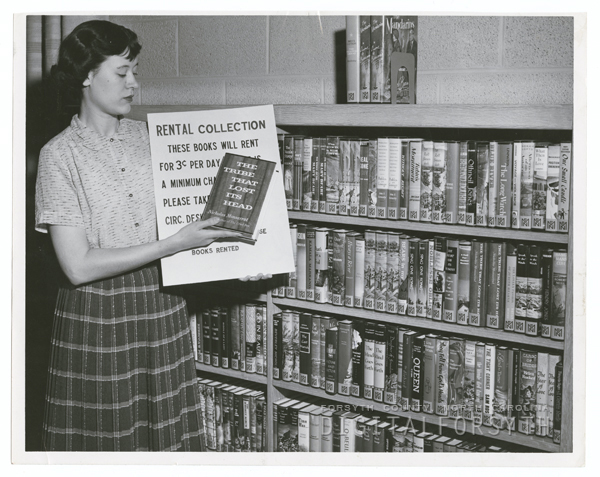 Jane Hill and the library's rental book collection, 1956.