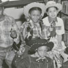 Children dressed as cowgirls and cowboys at the George Moses Horton Branch Library.