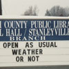 Rural Hall Branch Library sign, with snow on the ground, 1989.
