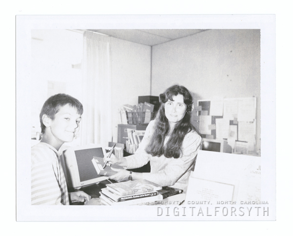 Library patron, Richard Prevette, and librarian Merrikay Brown at the Lewisville Branch Library, 1989.
